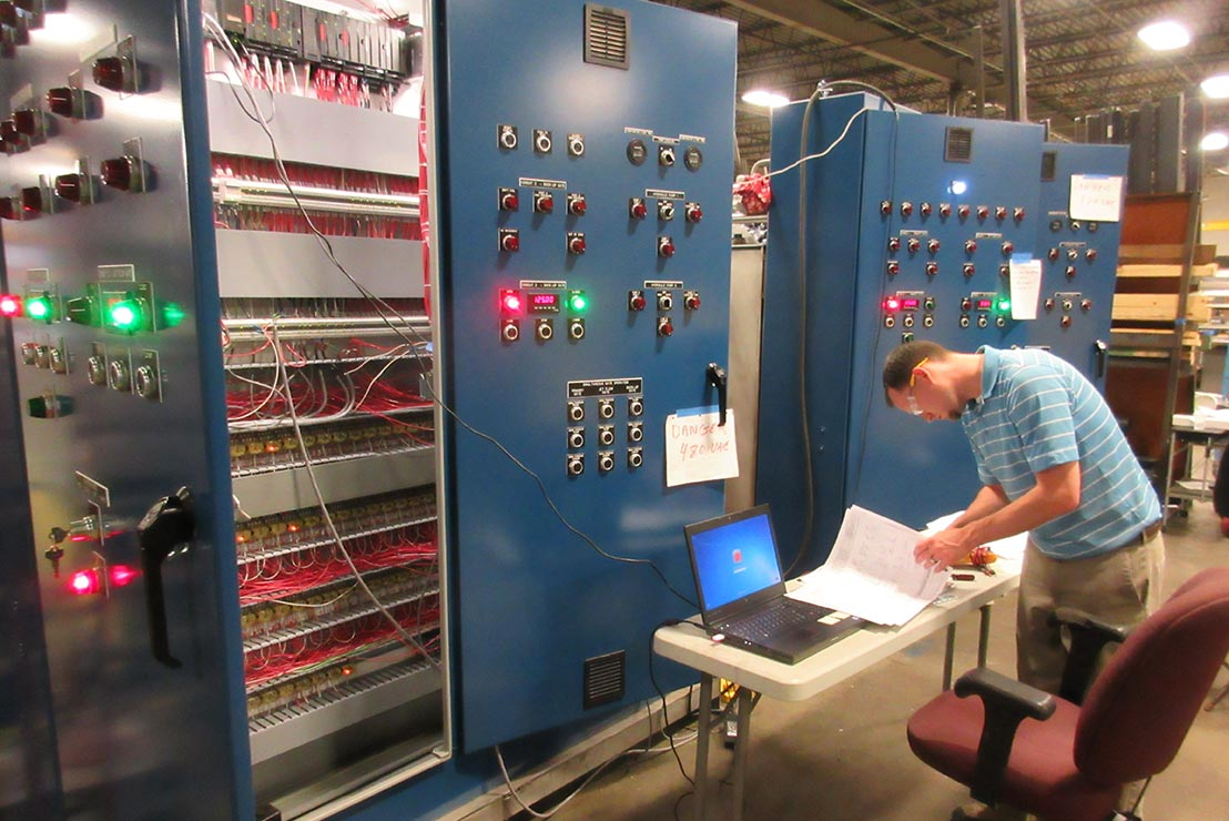 Engineer Programming Gate and Valve Operating System for Thornton Dam Reservoir